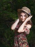 Menina no vestido e no chapéu nacionais Imagens de Stock