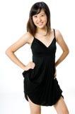 Menina no vestido preto Fotos de Stock Royalty Free