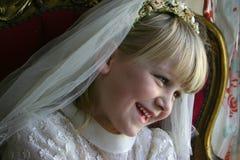 Menina no vestido santamente do comunhão imagens de stock royalty free