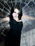Menina no vidro batido Fotografia de Stock Royalty Free