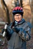 Menina nos capacetes na natureza Fotos de Stock Royalty Free