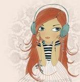A menina nos fones de ouvido Imagens de Stock