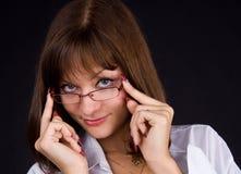 Menina nos vidros Fotos de Stock Royalty Free