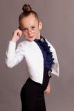 Menina nos vidros vestidos como a senhora do negócio Fotografia de Stock