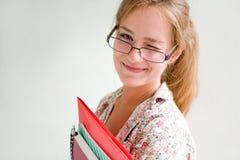 Menina nova bonita amigável do estudante. imagem de stock