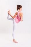 Menina nova da aptidão da ioga de Attarctive. fotografia de stock royalty free