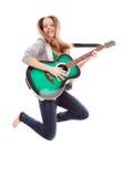 Menina bonita com a guitarra no fundo branco Fotos de Stock Royalty Free