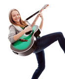 Menina bonita com a guitarra no fundo branco imagens de stock royalty free