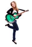 Menina bonita com a guitarra no fundo branco imagem de stock royalty free