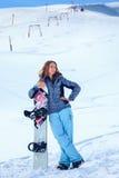 Menina nova do snowboarder Fotos de Stock Royalty Free
