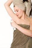 Menina nova do wellness com desodorizante Imagem de Stock Royalty Free