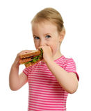Menina nova que come o sanduíche Fotos de Stock