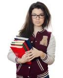 A menina o estudante com os livros nas mãos fotos de stock royalty free