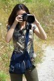 A menina o fotógrafo foto de stock