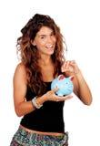Menina ocasional com um mealheiro azul Foto de Stock Royalty Free