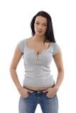 Menina ocasional nas calças de brim e no t-shirt Foto de Stock Royalty Free