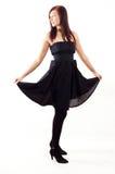 Menina ocasional que desgasta um vestido preto Foto de Stock Royalty Free