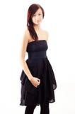 Menina ocasional que desgasta um vestido preto Fotos de Stock Royalty Free