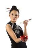 Menina oriental com chopstick Imagem de Stock Royalty Free