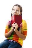 Menina pensativa do adolescente com livro fotos de stock royalty free
