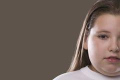 Menina pensativa excesso de peso séria Fotos de Stock
