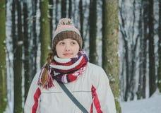 Menina pensativa no parque do inverno Imagem de Stock Royalty Free