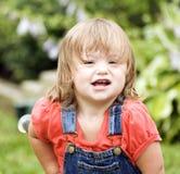 Menina pequena com bicicleta fotos de stock royalty free