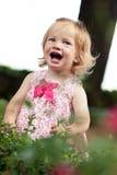 Menina pequena da criança no vestido cor-de-rosa foto de stock royalty free