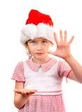 Menina pequena em Santa Hat Fotografia de Stock