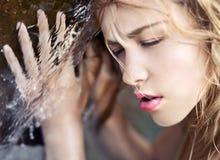 Menina perto da água Imagens de Stock Royalty Free