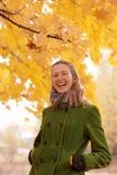 Menina perto da árvore do outono Foto de Stock Royalty Free