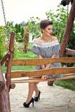 Menina perto dos girassóis em um vestido curto 12 Foto de Stock Royalty Free