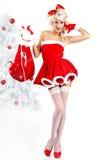 Menina Pin-acima que desgasta a roupa de Papai Noel Fotos de Stock Royalty Free