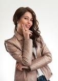 Menina positiva que sonha e que olha flertando Fotografia de Stock Royalty Free