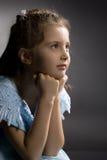 Menina pouco consideravelmente pensativa na poltrona fotografia de stock