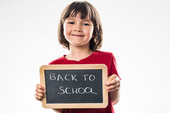 Menina pré-escolar bonita orgulhosa que aprecia sobre o divertimento de volta à escola Imagens de Stock
