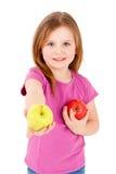 Menina pré-escolar que guarda uma maçã Imagens de Stock