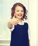 menina Pre-adolescente que mostra os polegares acima Imagens de Stock Royalty Free