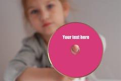 A menina prende o CD Imagens de Stock Royalty Free