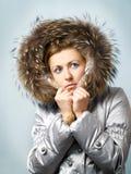 Menina preocupada na capa Imagens de Stock Royalty Free