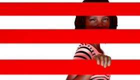 Menina preta atrás das barras Imagens de Stock Royalty Free