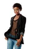 Menina preta nova no blazer e nas calças de brim imagens de stock royalty free