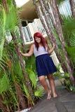 Menina principal vermelha tropical fotografia de stock