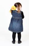 Menina que abraça seu brinquedo enchido Imagem de Stock Royalty Free