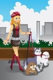 Menina que anda seus cães Imagens de Stock Royalty Free