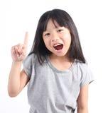 Menina que aponta acima com seu dedo Foto de Stock Royalty Free