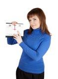 Menina que aponta até agora no calendário da aleta Imagem de Stock