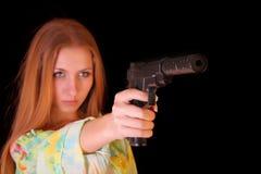 Menina que aponta com injetor Fotografia de Stock