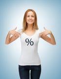 Menina que aponta no sinal de por cento Foto de Stock
