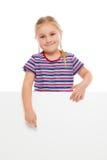 Menina que aponta no whiteboard. Fotos de Stock